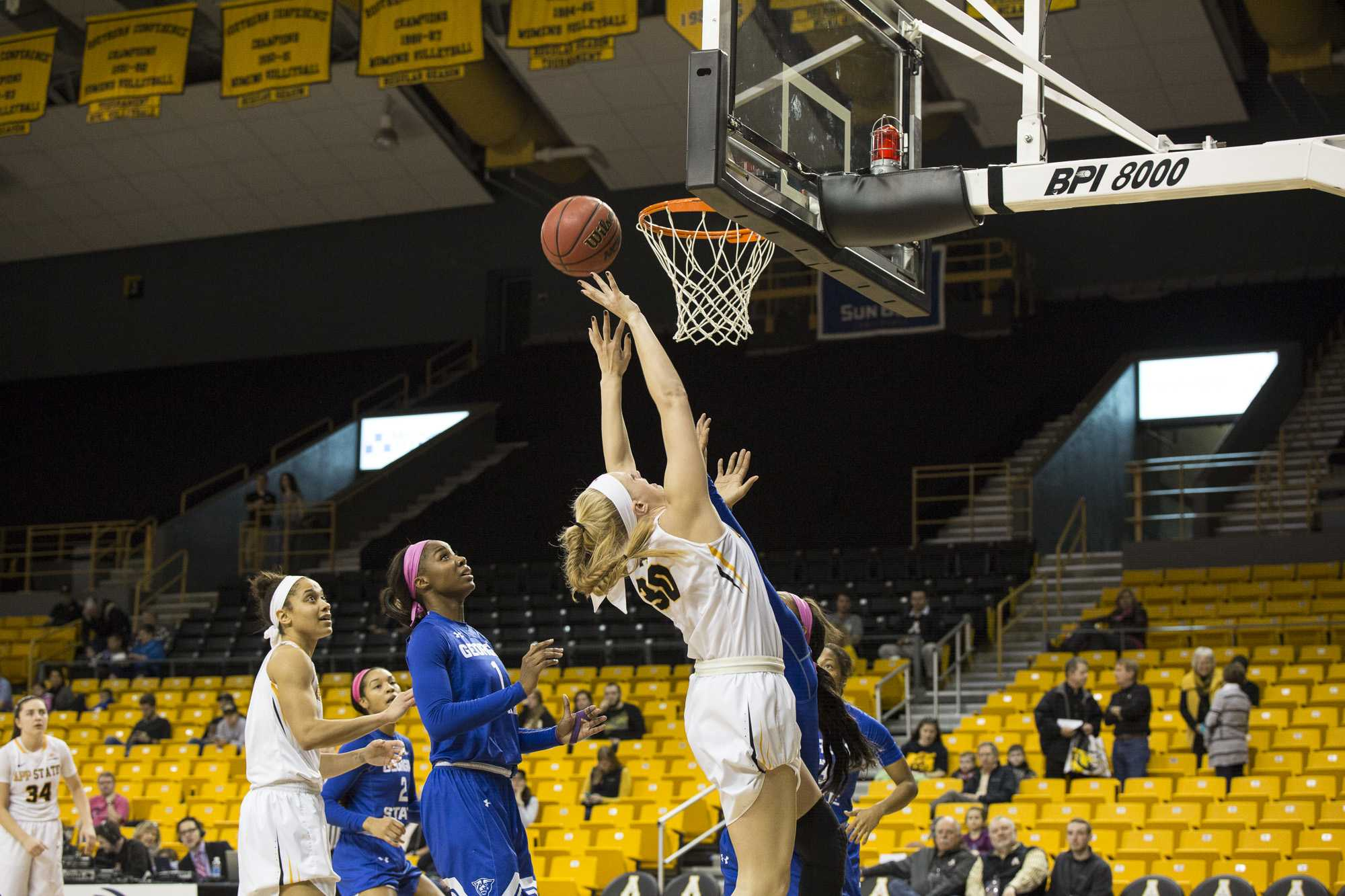 App State's Ashley Bassett-Smith drives through Georgia State defenders to score for the Mountaineers.