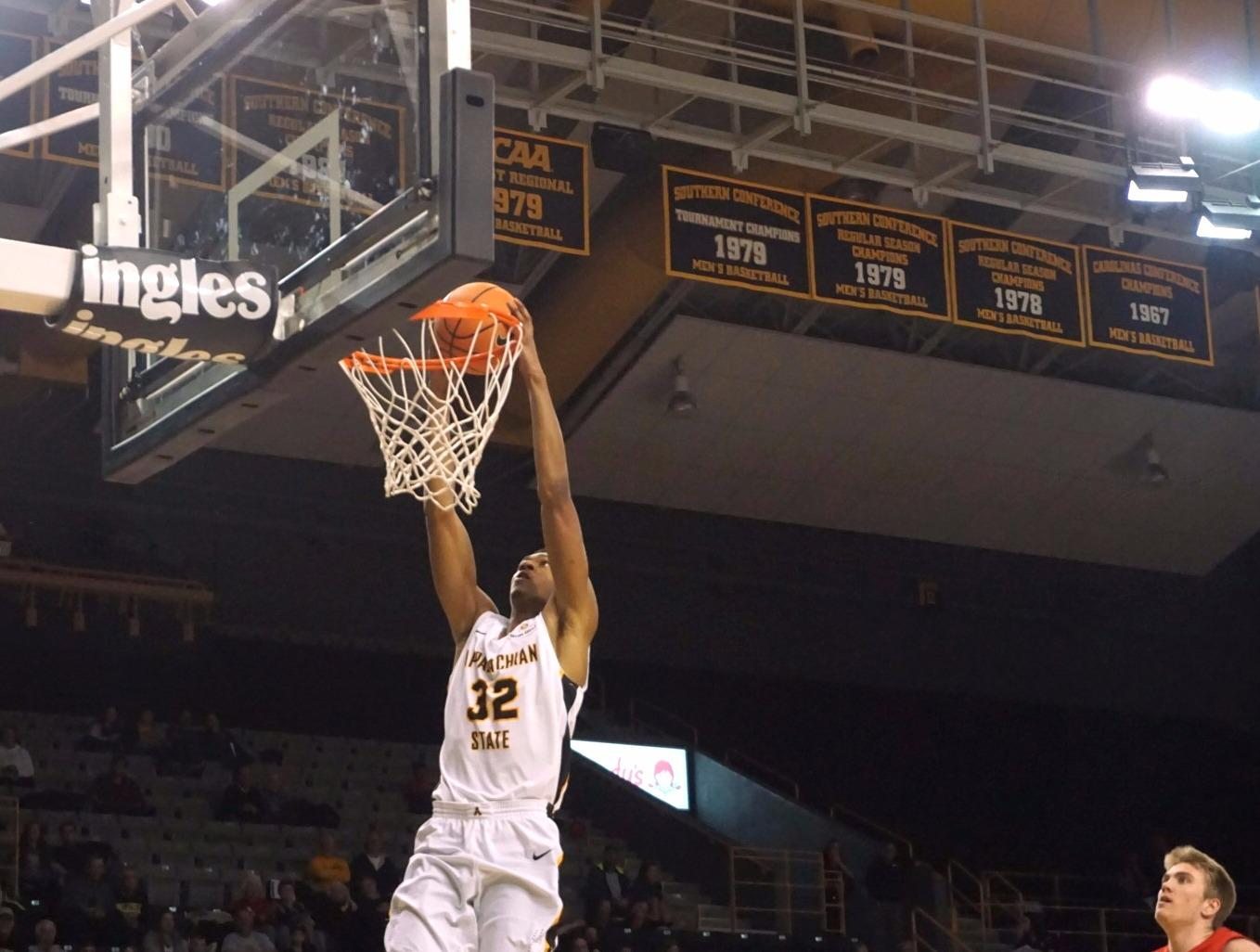 Tyrell Johnson going up for the two-handed slam after a steal