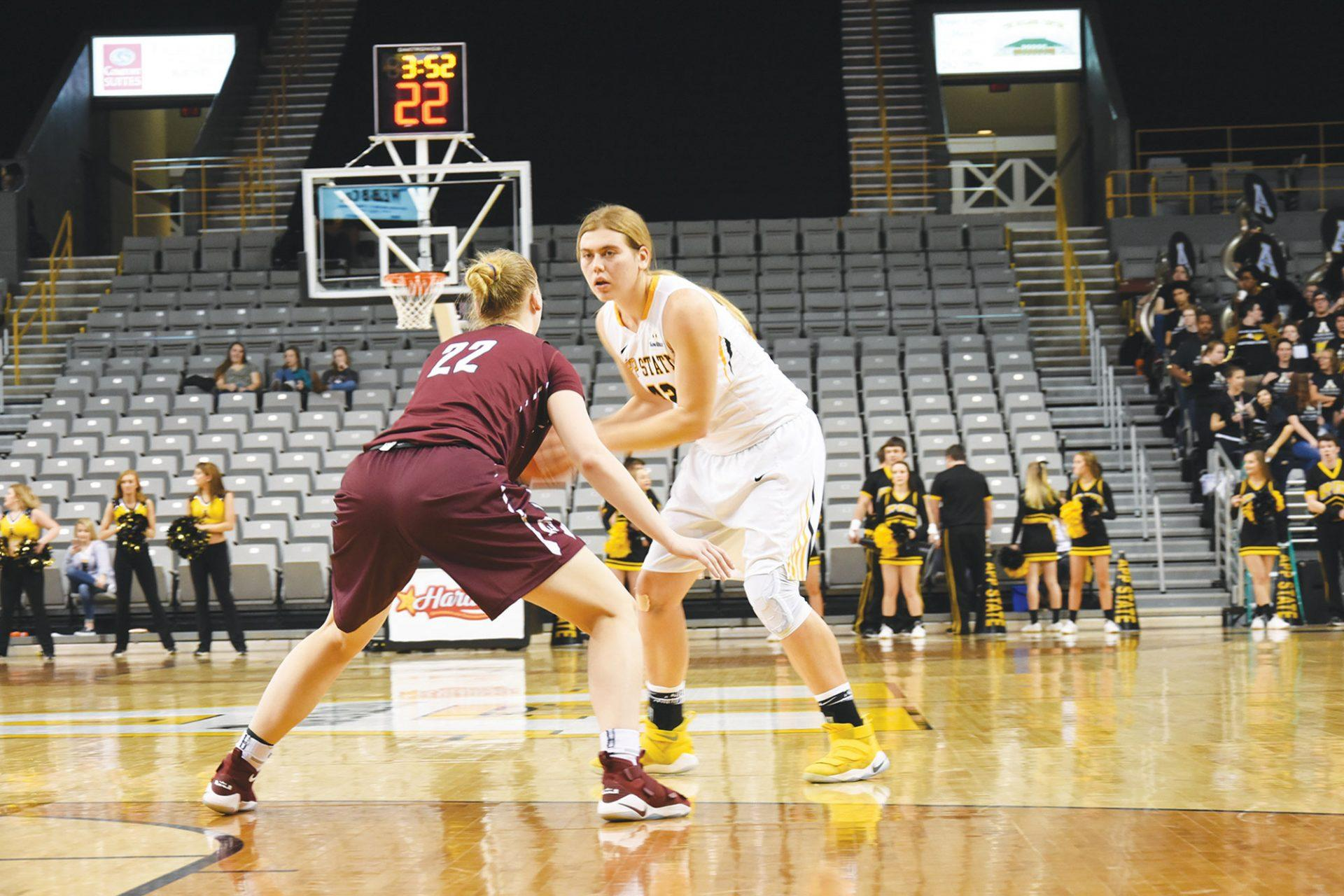 Bayley Plummer looking for a teammate to catch the basketball. The Mountaineers lost against the Trojans 52 to 40.
