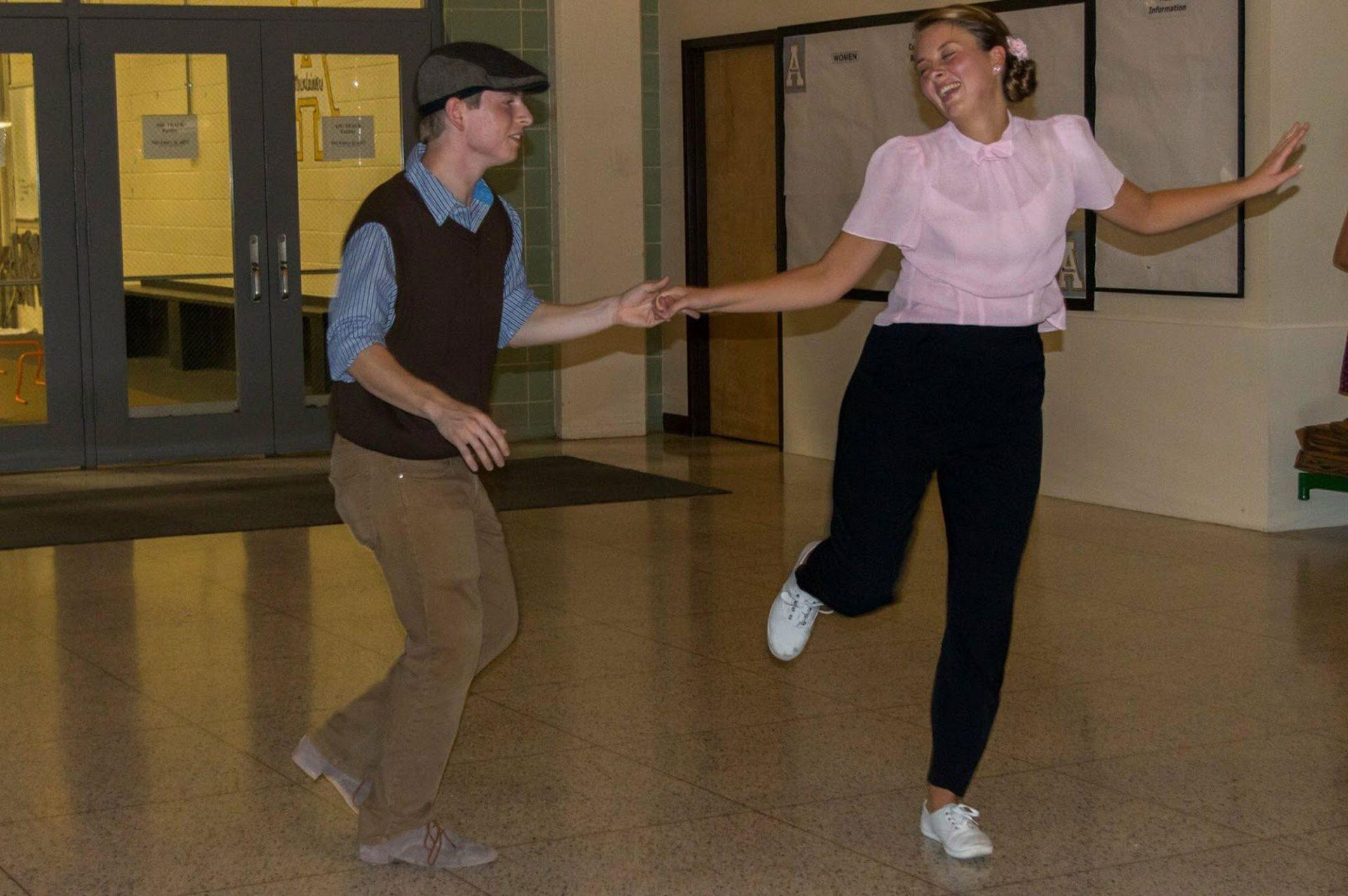 Nate Patterson and Caroline Church dance Lindy Hop during a one of the clubs themed events. The club puts on other dances in addition to the Lindy Hop like the West Coast Swing and the Blues.