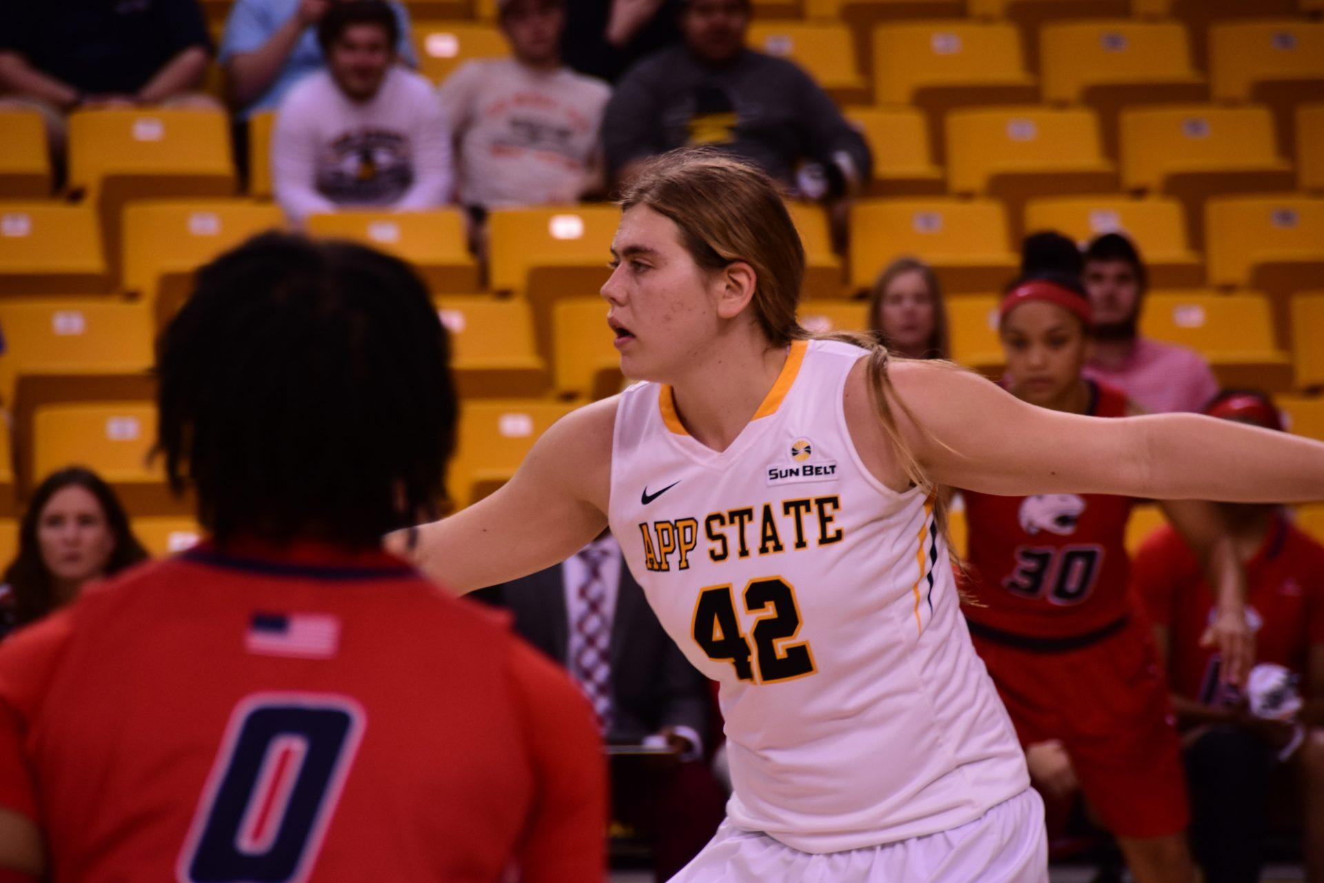 Sophomore Center Bailey Plummer puts up defense against the South Alabama Jaguars on Thursday.