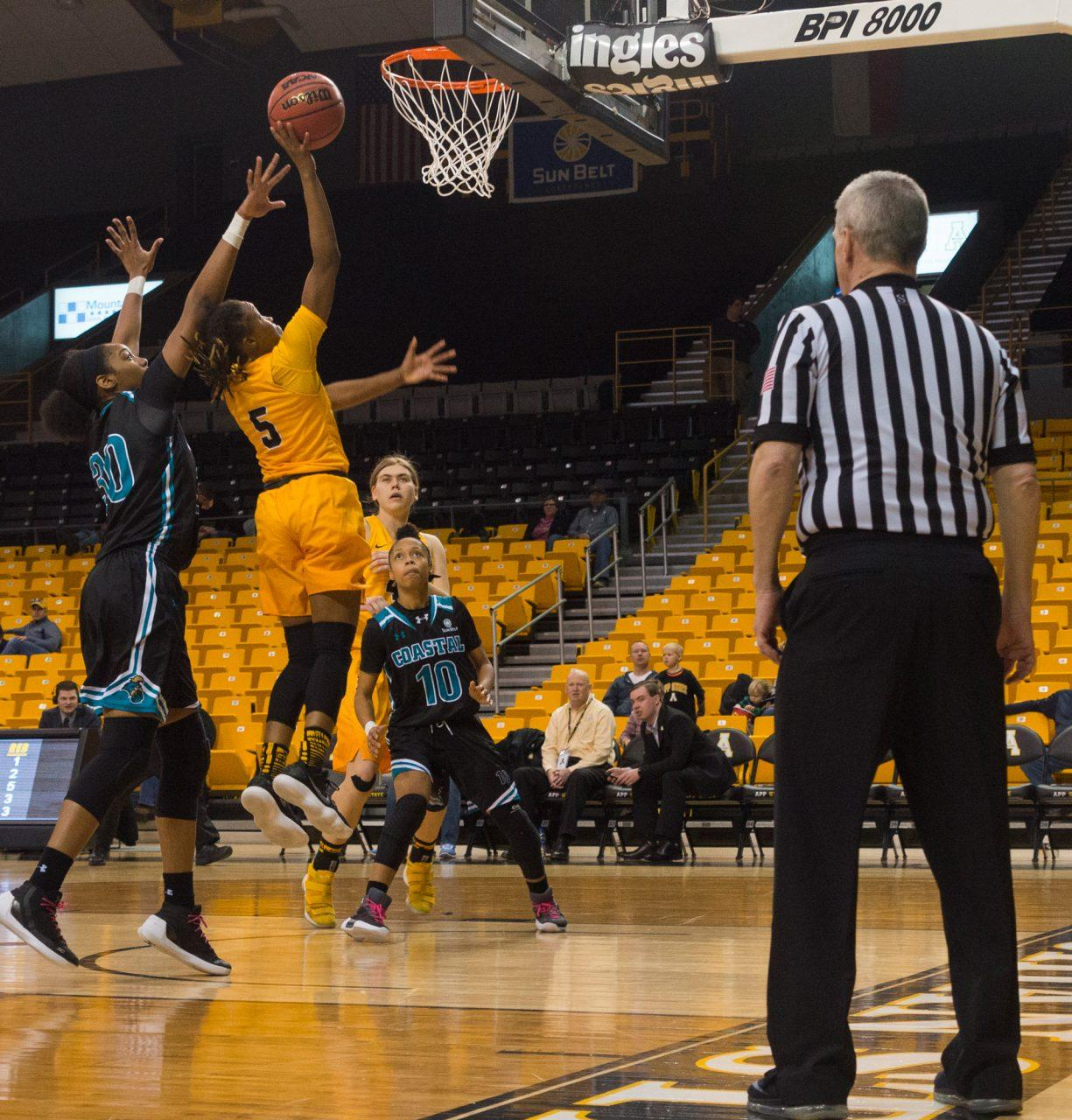 Junior guard Presha Stanley jumps with the ball and scores two points during an App State home game in 2018.