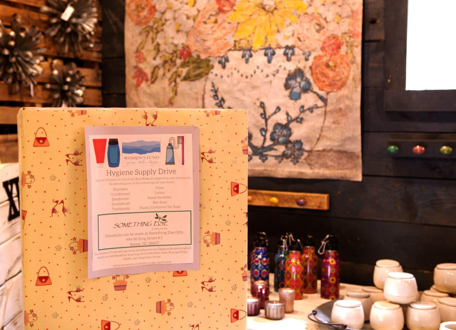 The donation box for the Hygiene Supply Drive, organized by the Women's Fund of the Blue Ridge, at Something Else in downtown Boone.