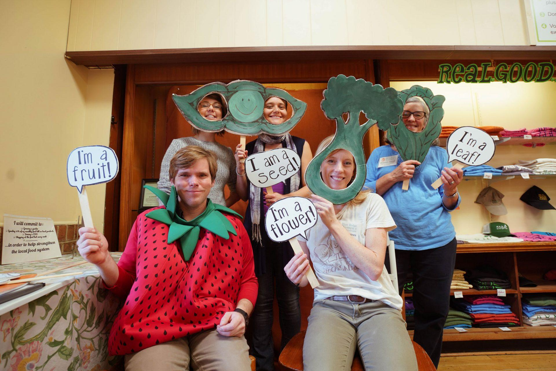 The Blue Ridge Women in Agriculture staff poses for a photo at F.A.R.M Cafe. Dave Walker, Director of Programs, stands out in his strawberry costume.