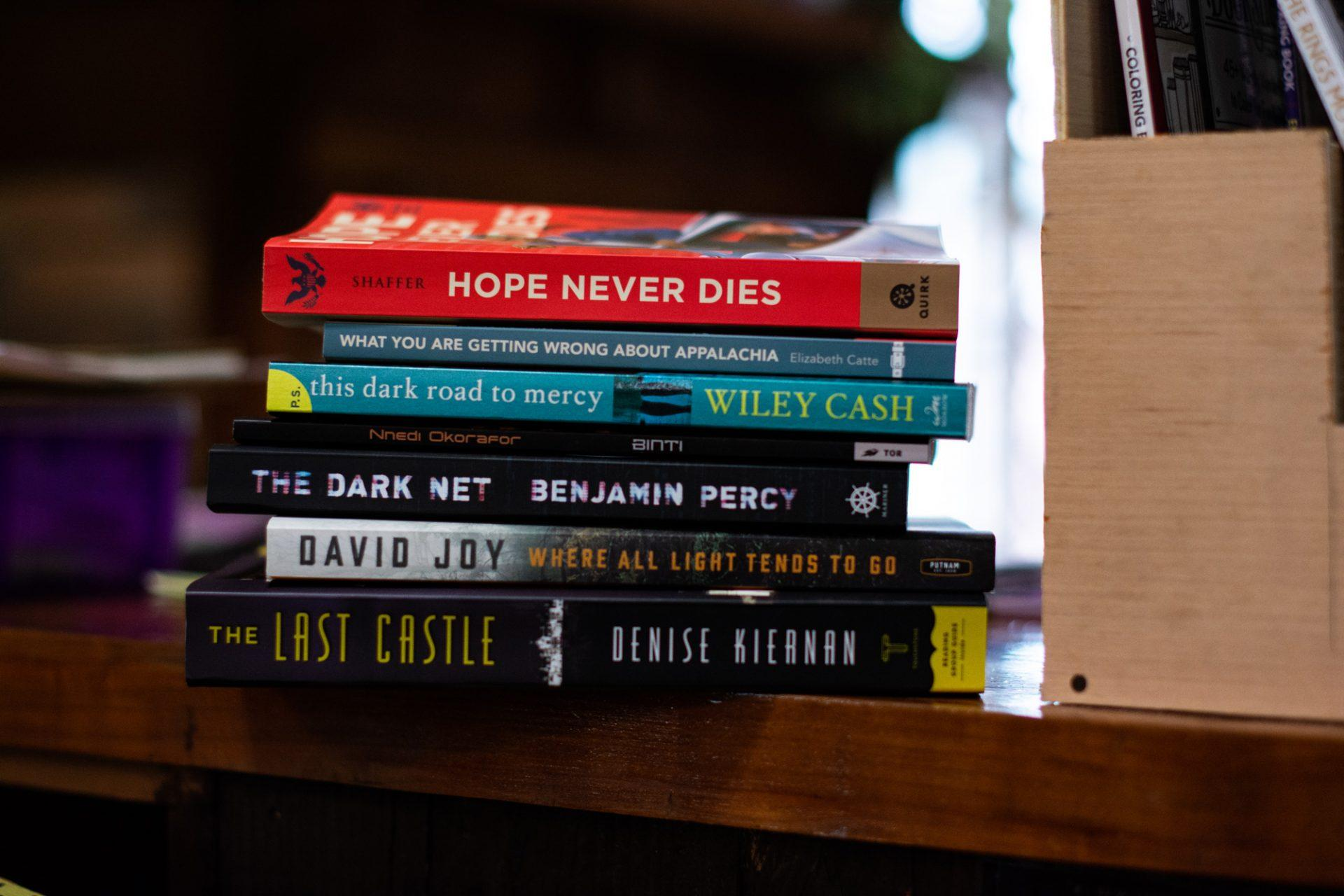 The current rotation of novels that are being read in Foggy Pines Books' various book clubs. The store offers several different book clubs for customers to join that meet throughout each month.
