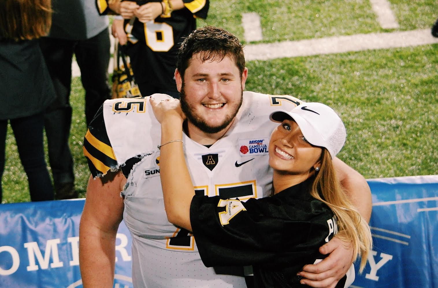 Katie Doge, founder of G7AMEDAY5, posing with Parker Collins, former App State football player. Dodge said Collins was her inspiration to create her clothing brand that features customized App State spirit wear.
