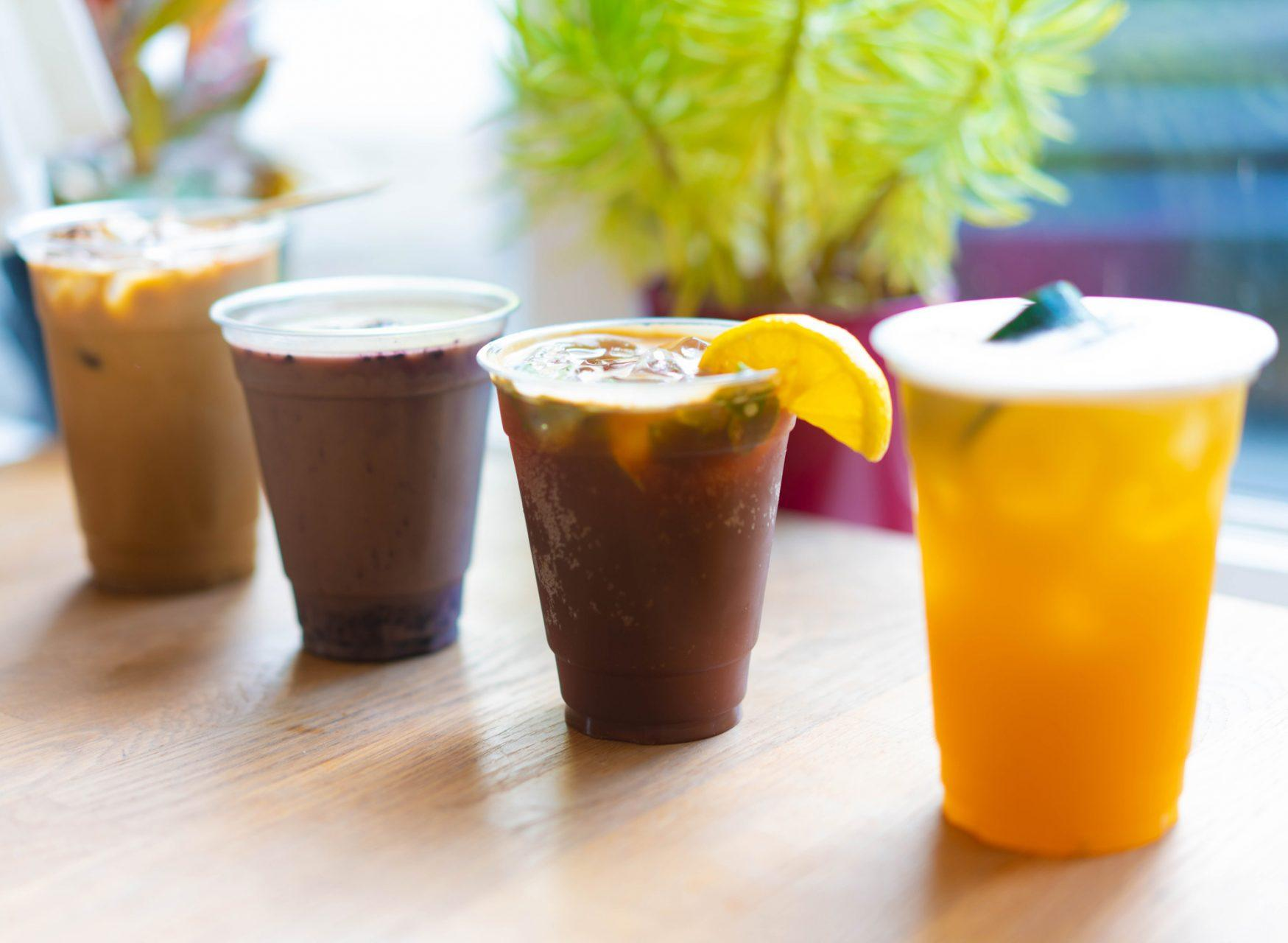 Lineup of Hatchet Coffee's four specialy drinks from their Summer Menu. From left to right is the Fireside, Blueberry Horchata, Camp Crush Coffee Soda and Porch Swing.