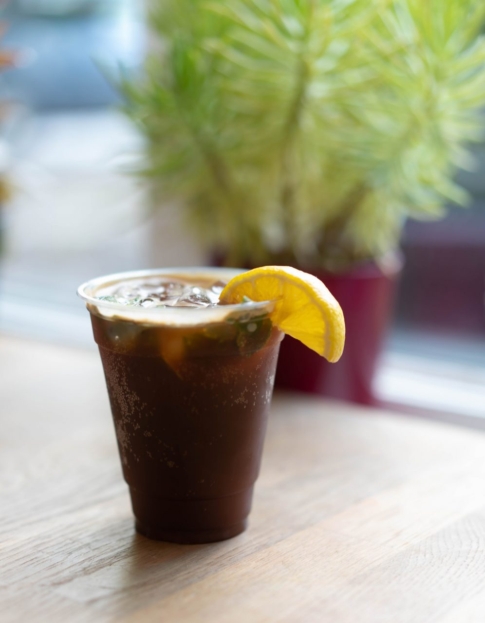 Hatchet Coffee's specialty drink, Camp Crush Coffee Soda, perfect for hot summer afternoons. This iced beverage is a lovely blend of espresso, blackberry soda, lemon and local purple basil.