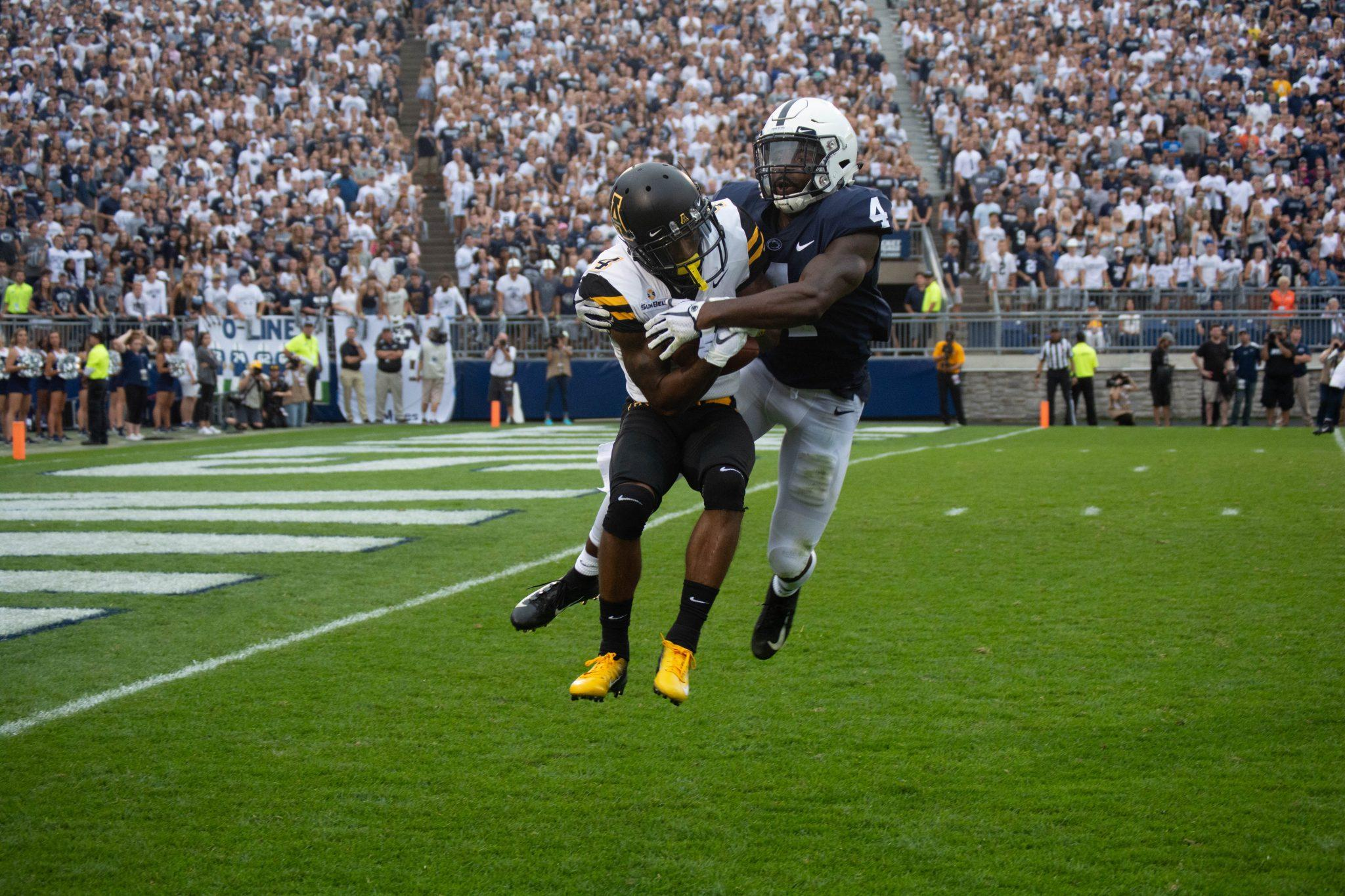 Graduate+transfer+wide+receiver+Dominique+Heath+fights+for+the+ball+against+a+Penn+State+defensive+back.+App+State+lost+to+the+Nittany+Lions+45-38.