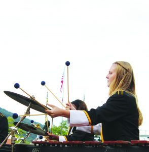 A percussionist performing in the Marching Mountaineers