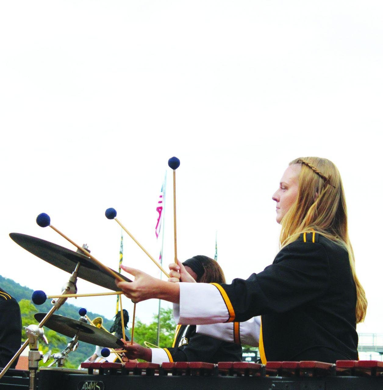 A percussionist performing in the Marching Mountaineers' half time show featuring songs from the iconic band Earth, Wind, and Fire at the first home football game of the season.