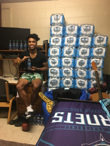 Cam Hunter's dorm room crammed full with water bottles. Hunter is the creator of