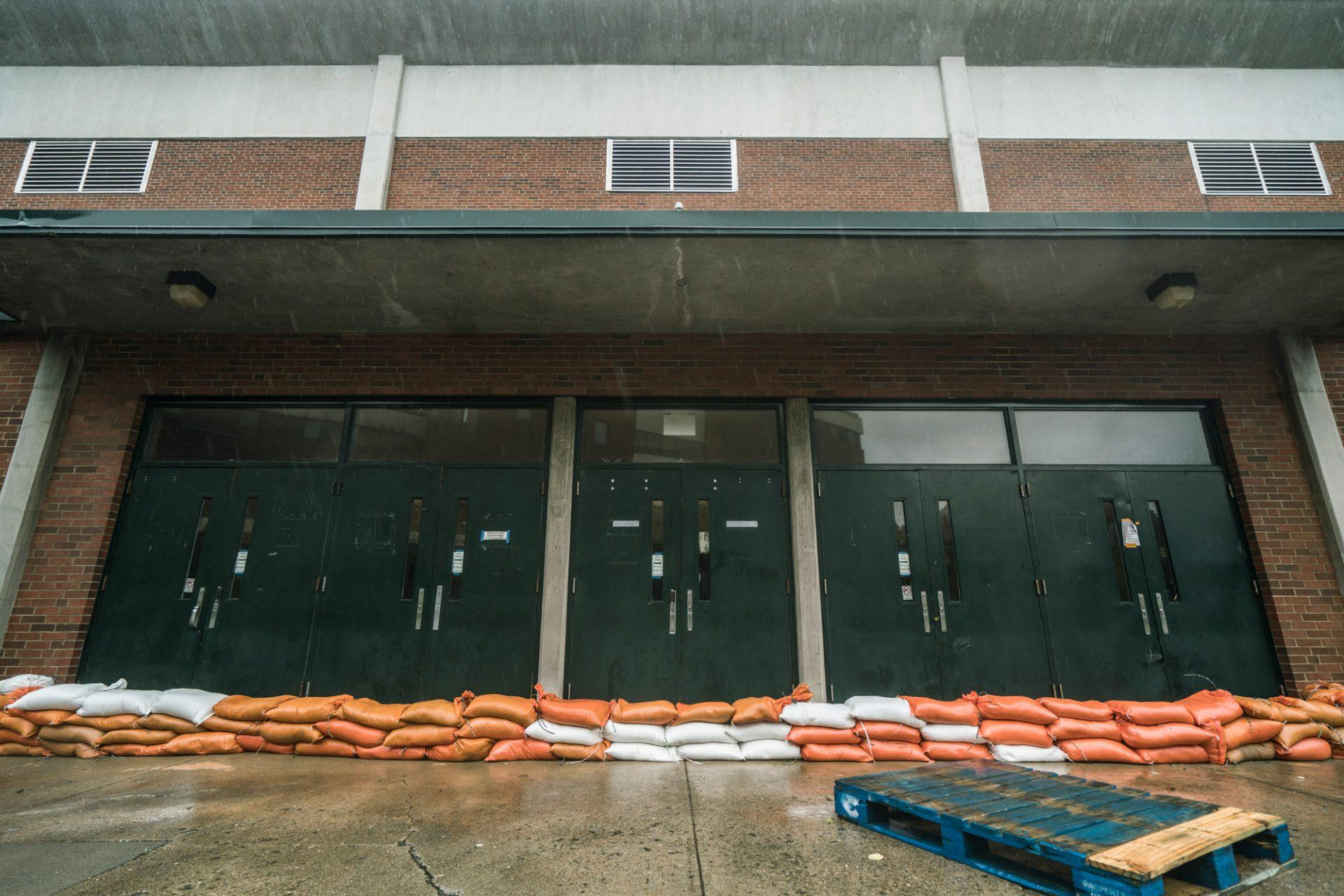 A wall of sandbags defend the Varsity Gym, one of the lowest points on campus, from floodwaters.
