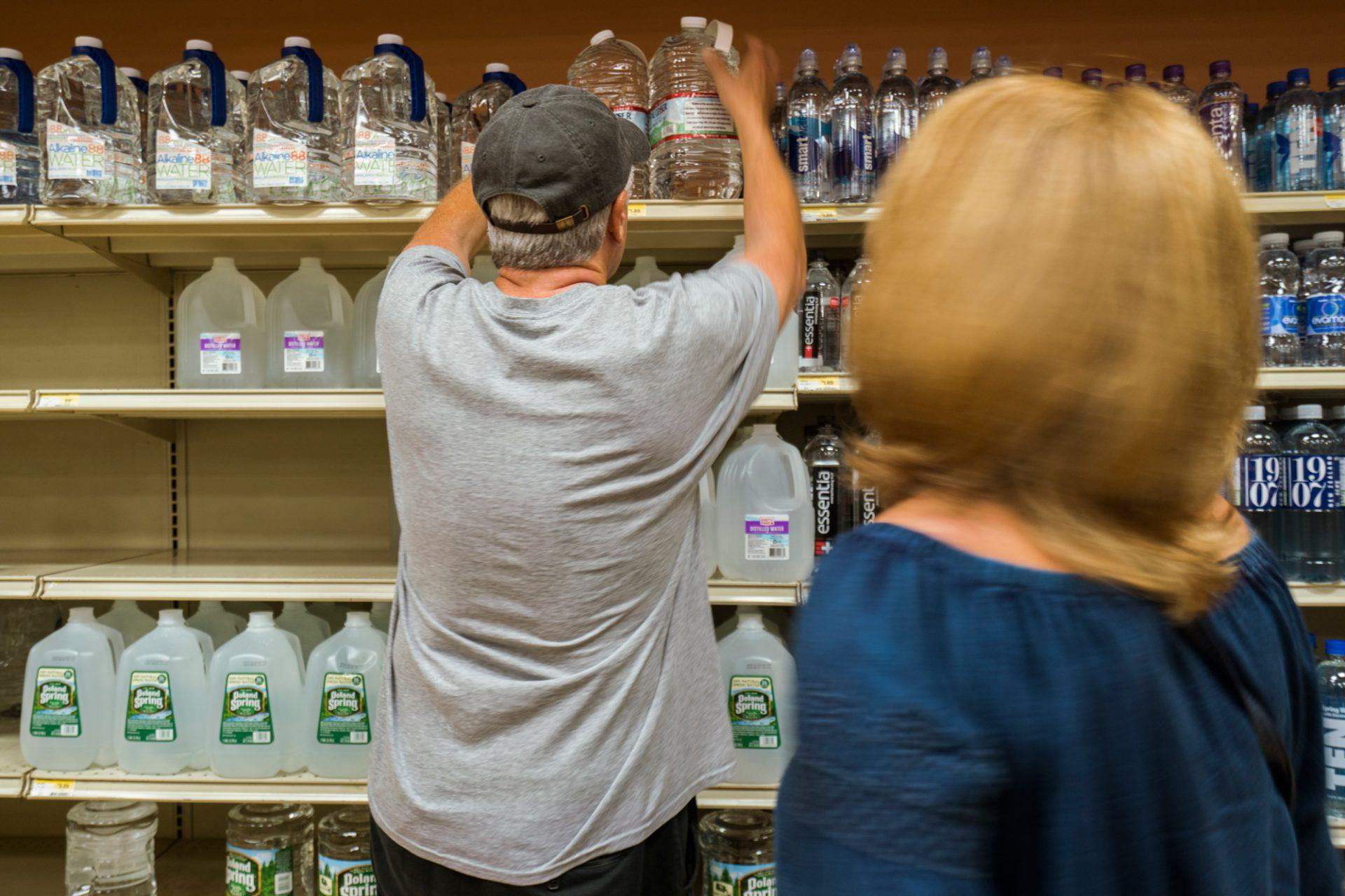 Boone couple Cathy Tarlton and Tim Tarlton purchase gallons of water at Earth Fare in preparation for Florence.