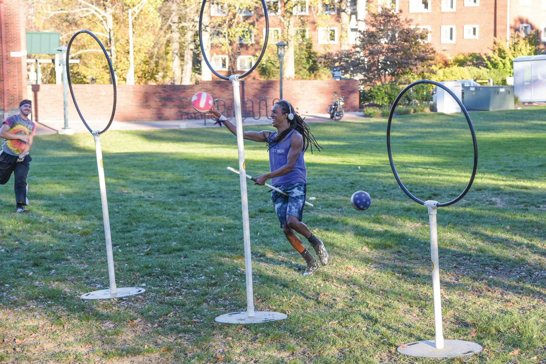 Brandon Poole throws the quaffle through one of the hoops to score during practice last October. The Appalachian Apparators practice every Tuesday and Thursday on Duck Pond Field.