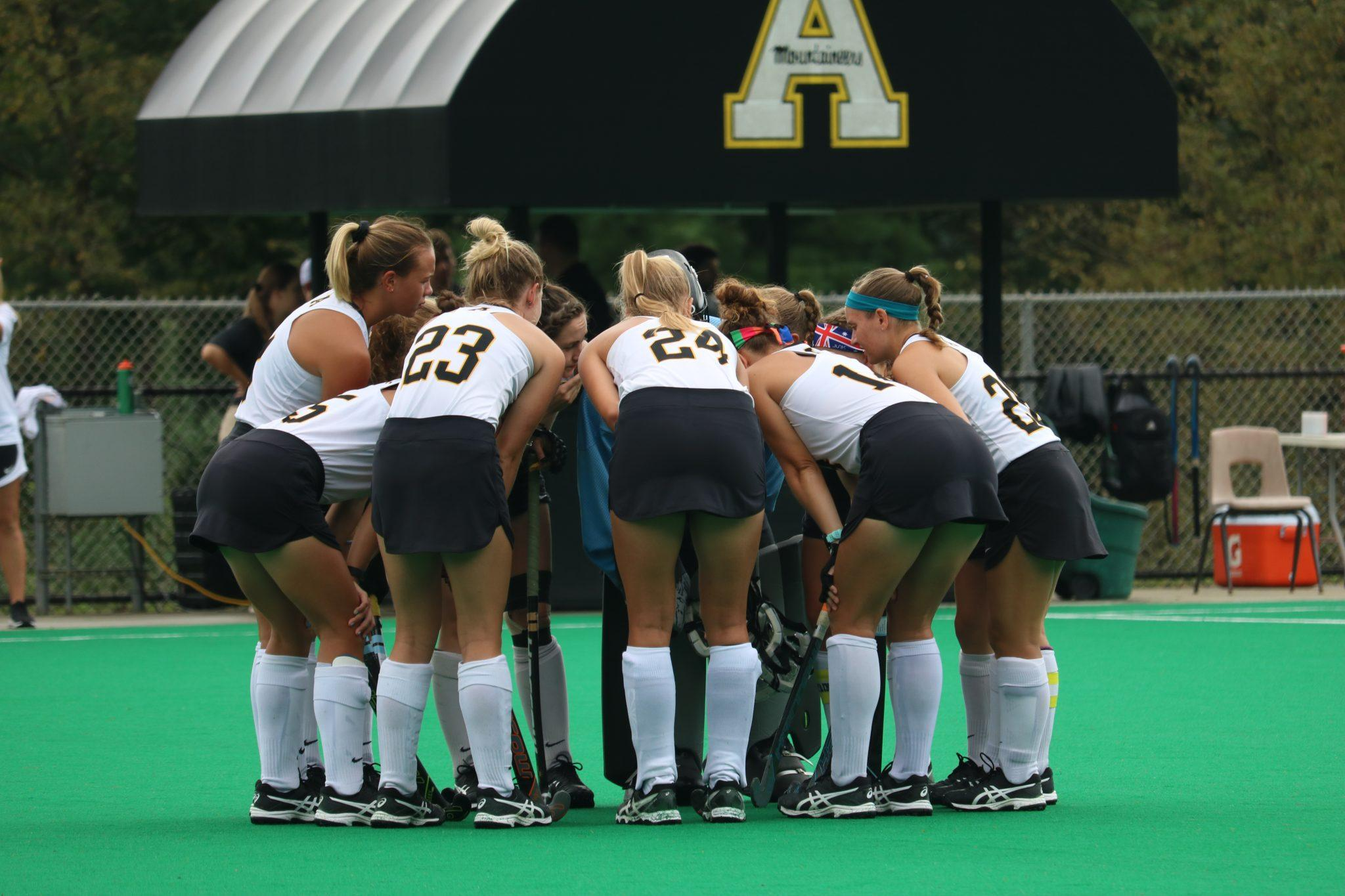 Field+hockey+huddles+up+during+their+home+game+against+Louisville.+