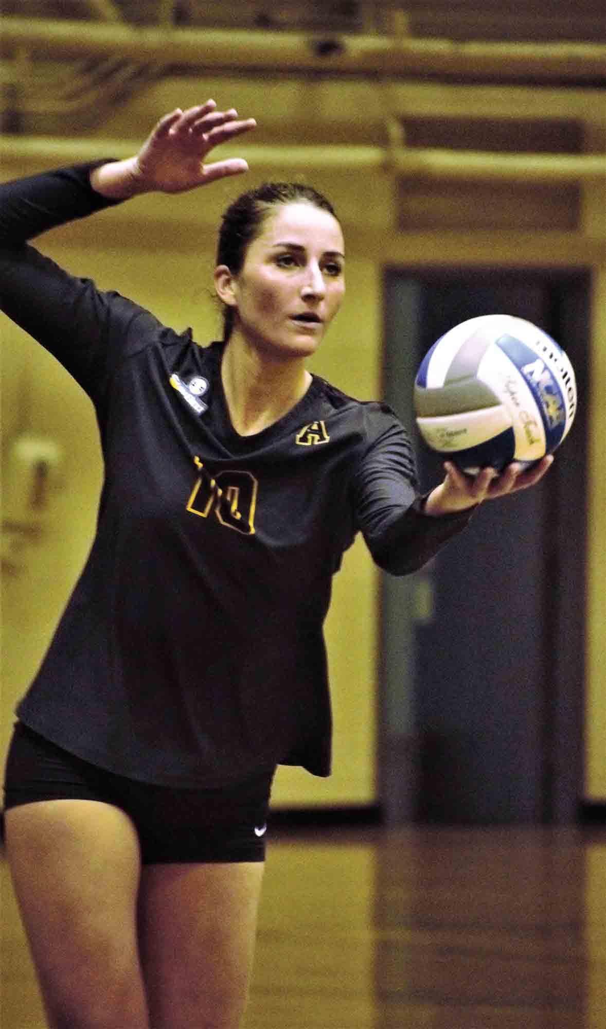 Senior transfer setter Becky Porter prepares to serve the ball.