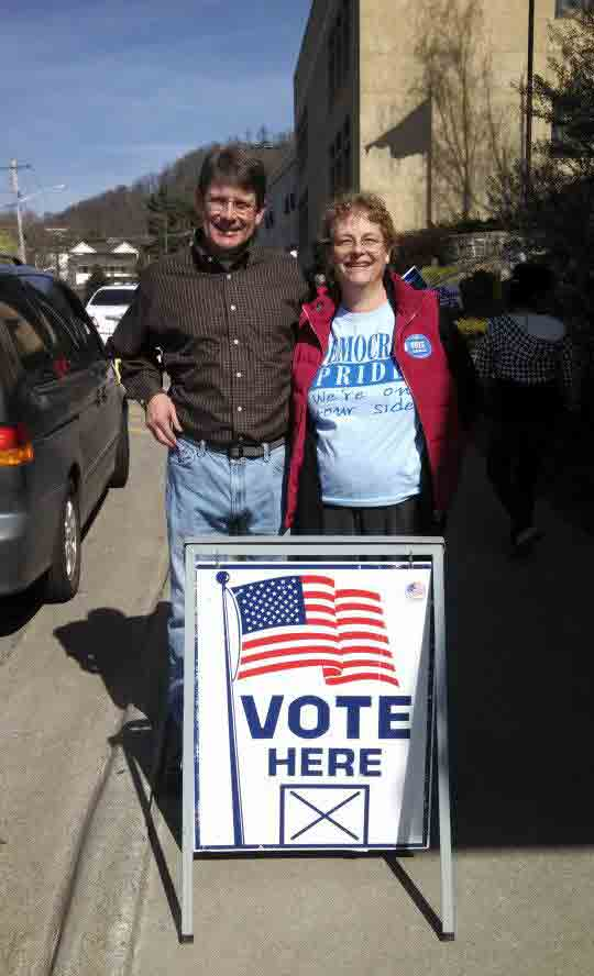 Billy Kennedy, candidate for County Commissioner, poses with a fellow democrat at the polls during last year's municipal elections.