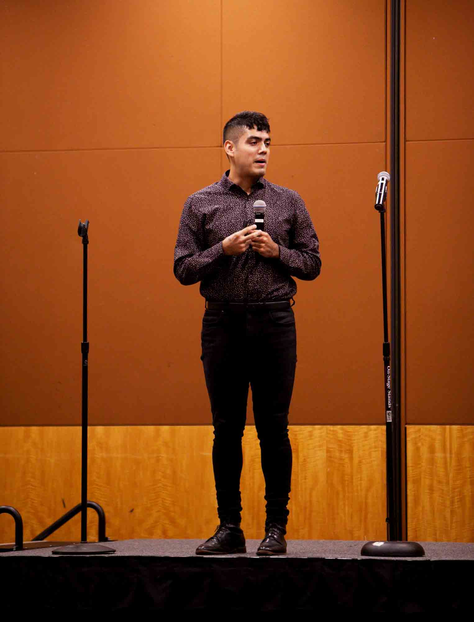 Saul Flores gives a moving speech to the audience at the Hispanic Heritage Festival Wednesday.