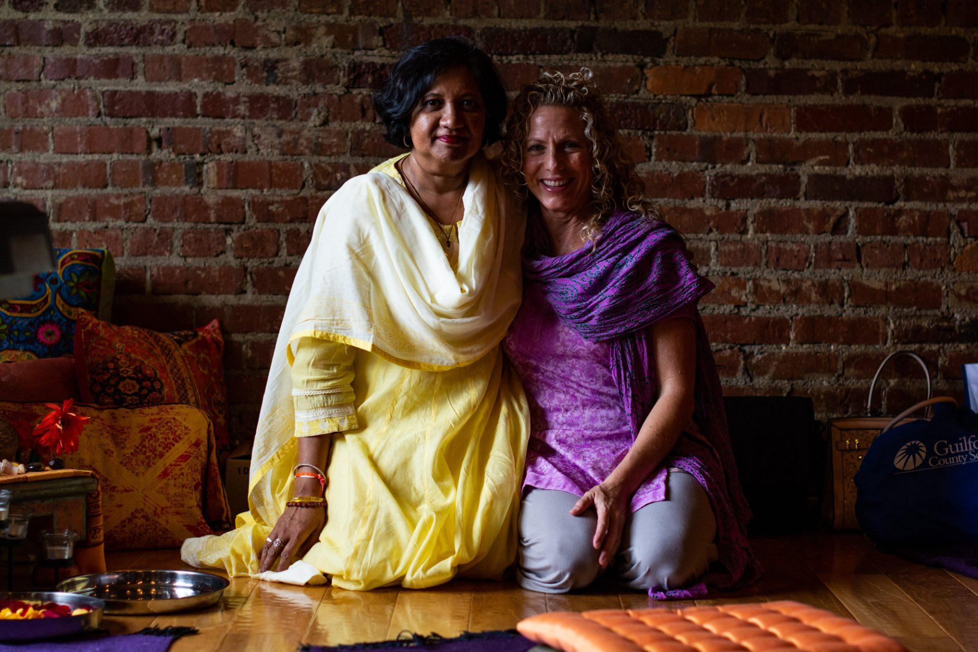 Christine Sita Dave (left) is the founder of EDGE, or Education for Girls Empowerment. Sita Dave's longtime friend of Valerie Midgett (right) is the owner of Neighborhood Yoga.