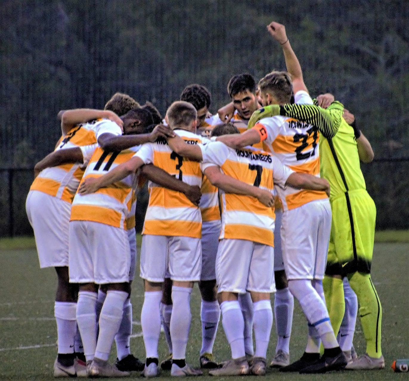 The App State men's soccer team huddles together during a game against Georgia State in 2018. Men's soccer, along with men's tennis and men's indoor track and field, have been canceled, athletic director Doug Gillin announced Tuesday.