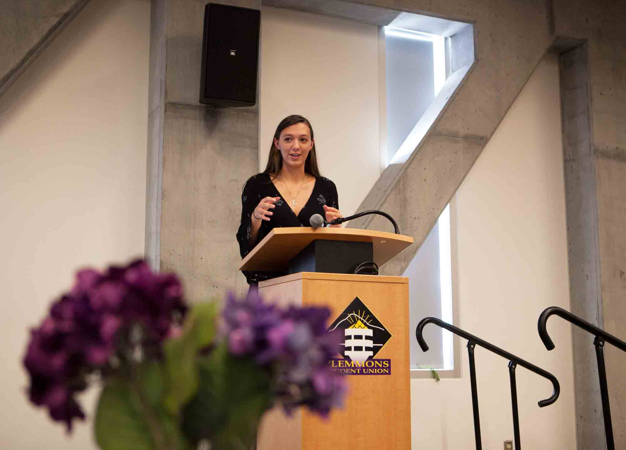 Sophomore Maddie Mullins speaks at the 20th anniversary celebration for the Women's Center on Sunday. Mullins spoke about the community the center has provided her.