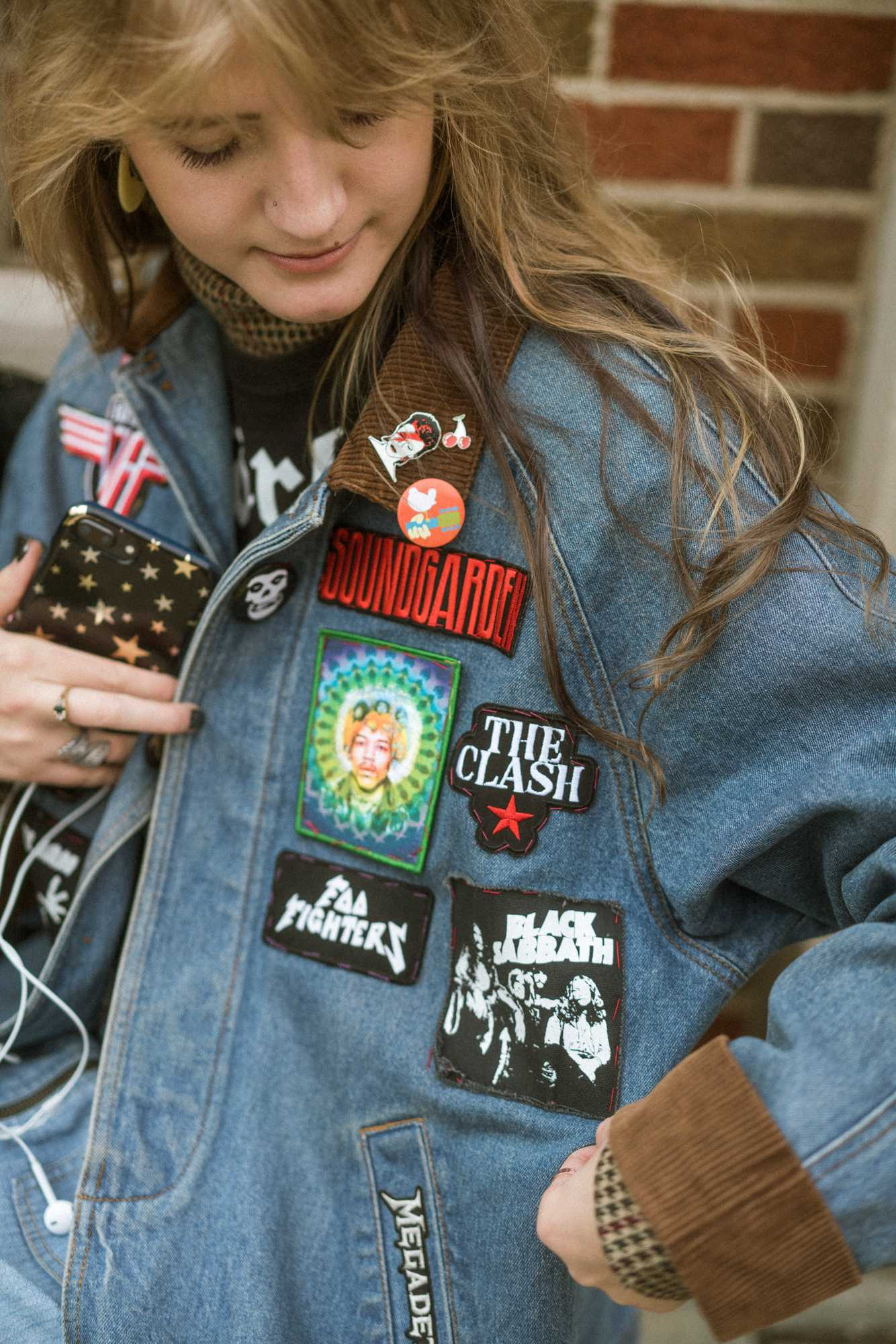Shanelle Meyer shows off her patches on her demin jacket.