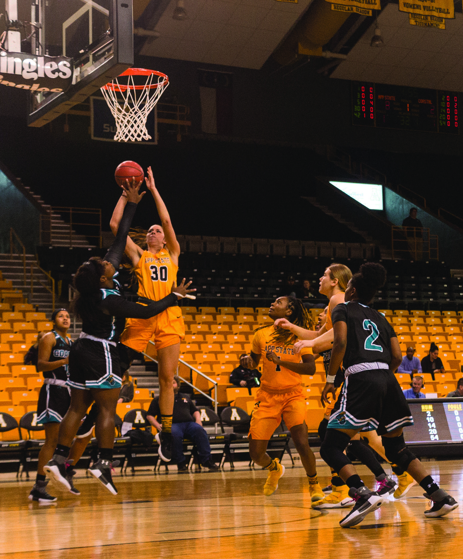 Freshman forward Lainey Cosnell makes a shot to score two points while teammates Bayley Plummer and Maya Calder position themselves to catch the rebound in the game against Coastal Carolina on Saturday, March 3rd.