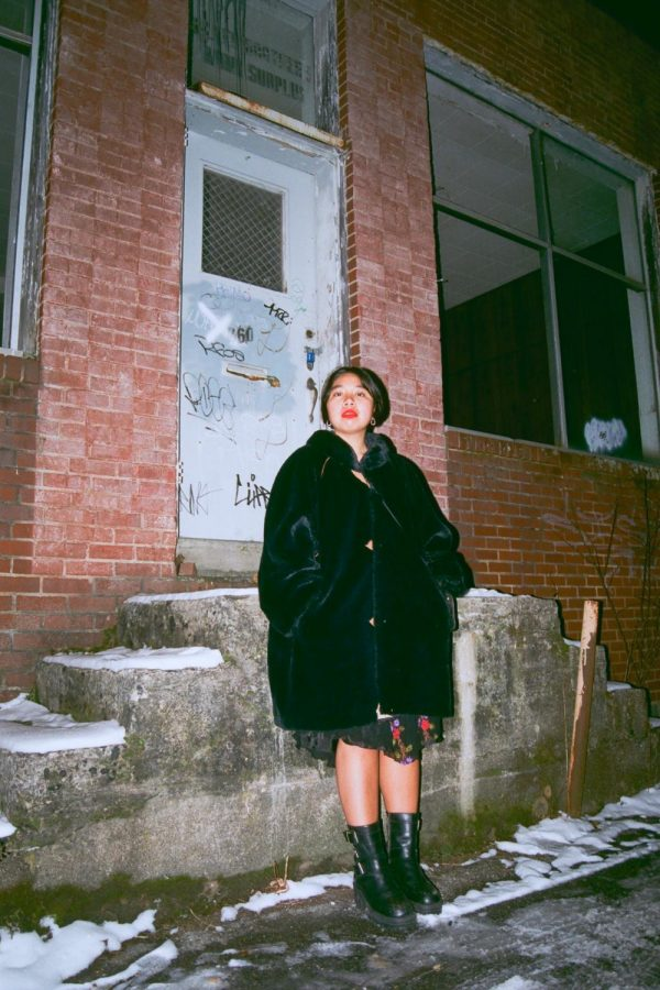 Ilyssa+Pachao%2C+draped+in+her+favorite+faux-fur+black+coat.+Pachao+has+a+keen+eye+for+one-of-kind+items+from+thrift+stores.