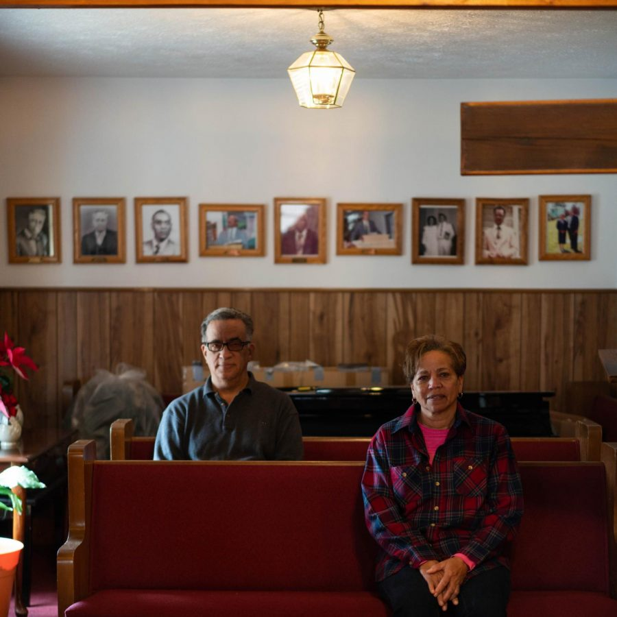 Lillian White and her fellow parishioner spend an afternoon at the church, preparing for a funeral. White has attended since childhood and sings in the choir.