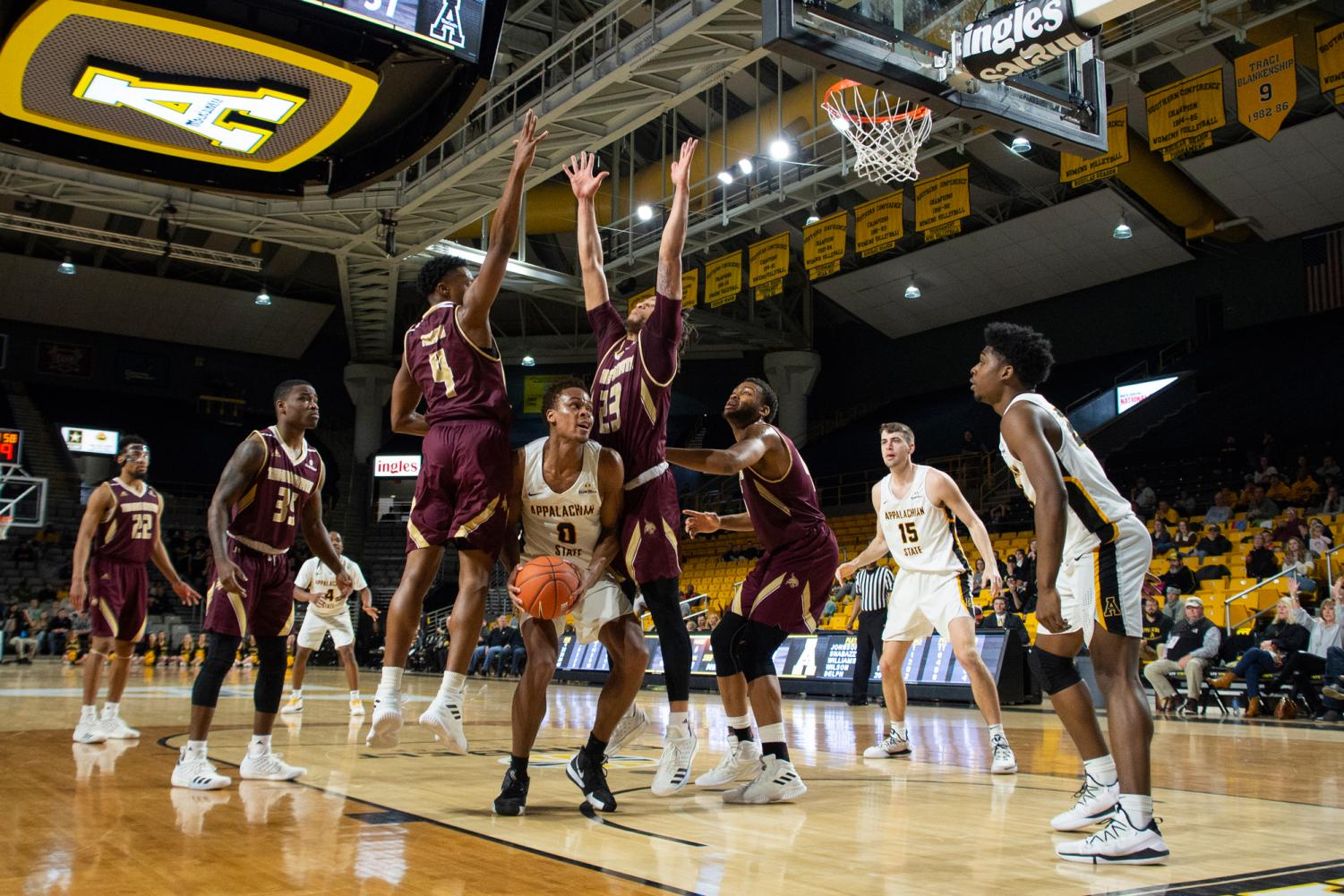 Senior forward Isaac Johnson fights through traffic under the basket at home against Texas State on Jan. 12.