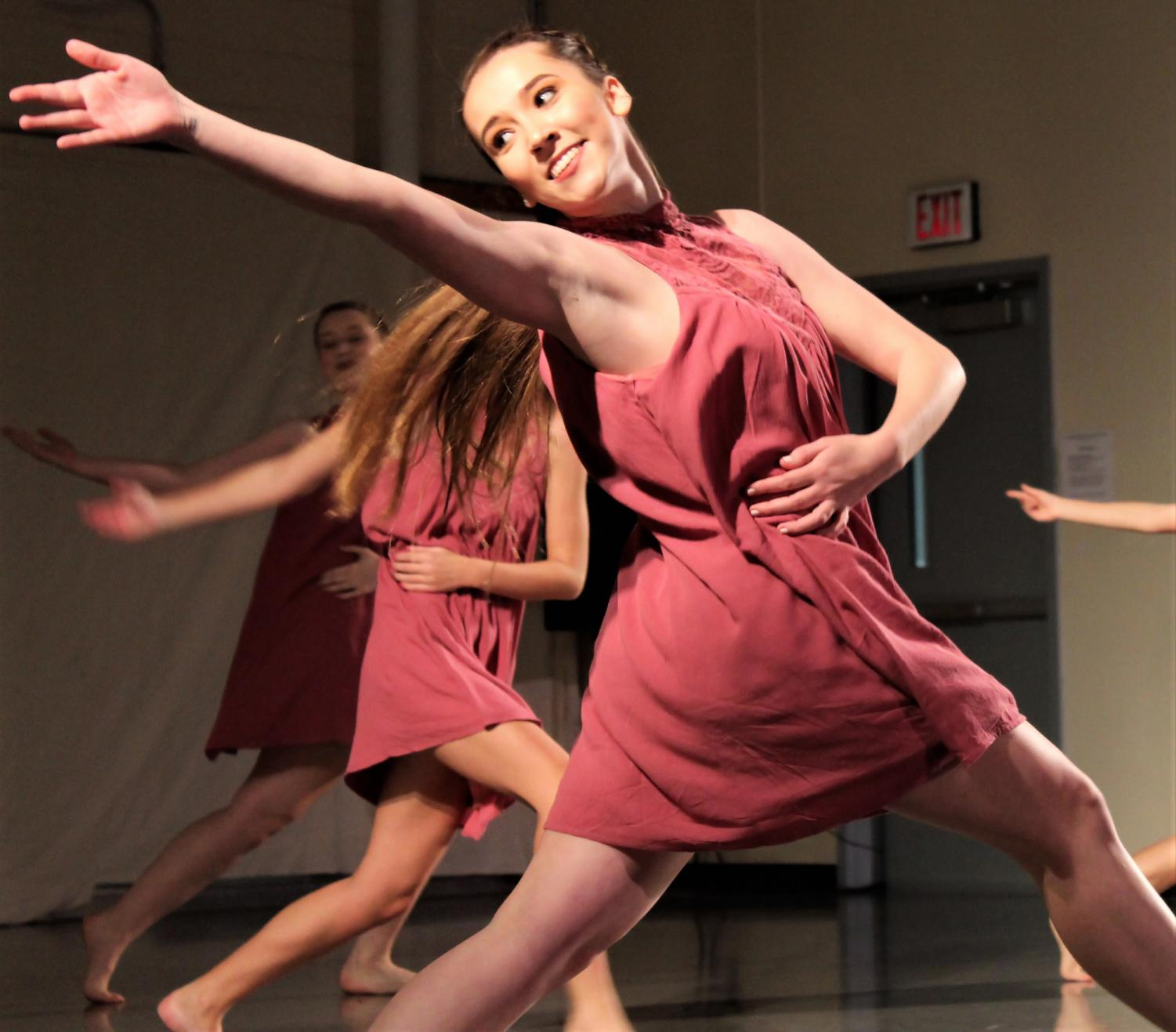 Freshman, Kennedy Bennett showcases her natural beauty through her movement in the piece 'Beautiful' choreographed by Rachel Bohannon.