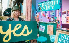 Elle Erickson sets up her shop in downtown Asheville. You can find free hugs, free advice, high fives, dancing and more at her traveling booth and thrift store.
