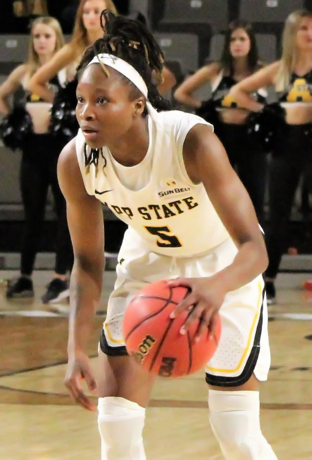 Sophomore+guard+Pre+Stanley+stares+down+her+defender+before+running+a+play+against+Arkansas+State+on+Jan.+24.+