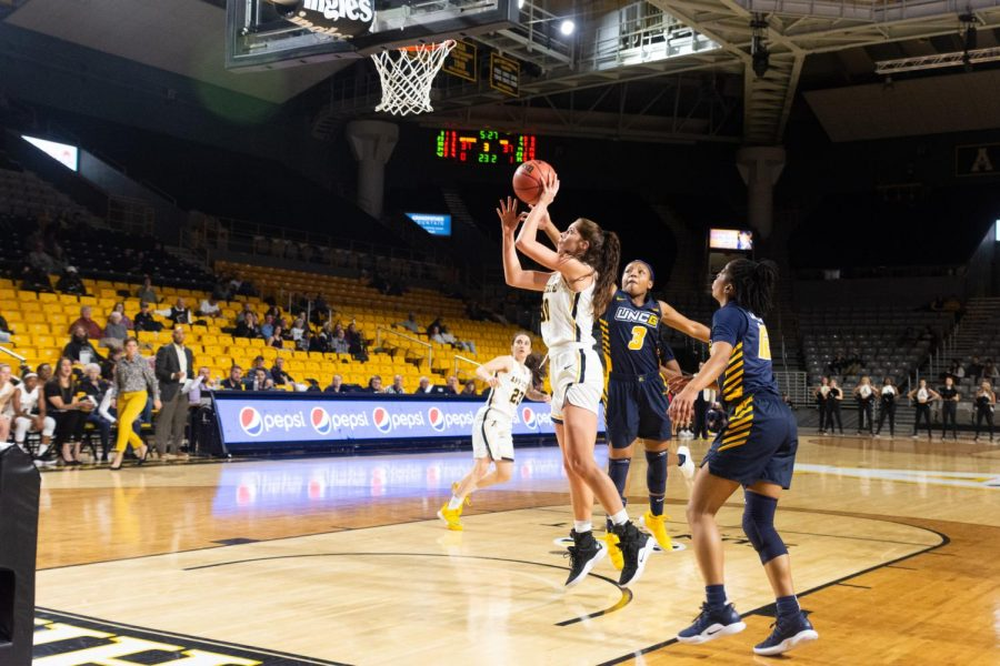 Sophomore forward Lainey Gosnell goes up for a lay-up in a close victory over UNCG.