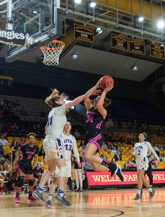 Senior guard Madi Story charges to the basket and draws a foul on the layup at the Play4Kay game.