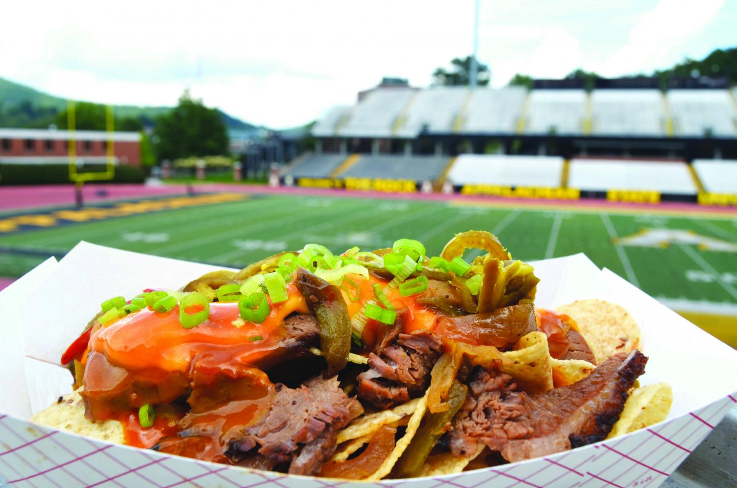 One of the featured dishes is brisket loaded nachos, which will be sold at the Smoke House: Hall of Fame stand. The menu was created by executive chef Tony Bates, who pulled barbecue inspiration from the Deep South. Courtesy of Food Services.