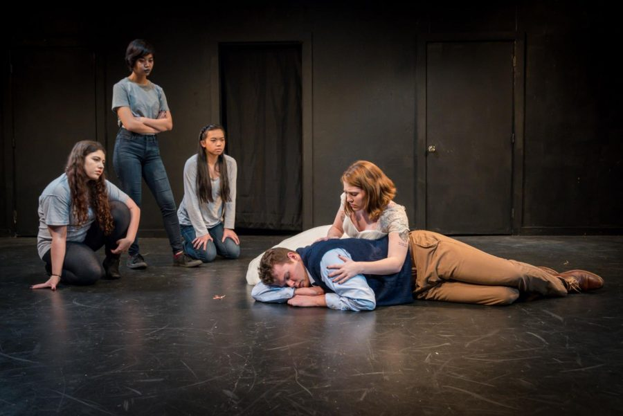 Eurydice, played by junior theatre arts major Zoe Dean, embraces her father, played by junior theatre arts major Shane Buchheit, while the Little Stone, Big Stone and Loud Stone (theatre arts sophomore Xeleighta Bernardo, theatre arts senior Kaitlyn Lyon and management sophomore Emma Harkins) look on.