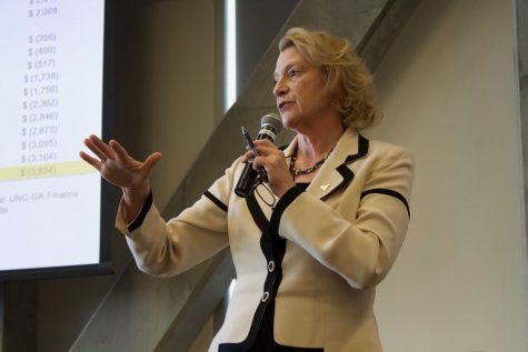 Chancellor Sheri Everts addressing faculty at a special faculty senate meeting called to discuss the stagnation of salaries in February 2018.