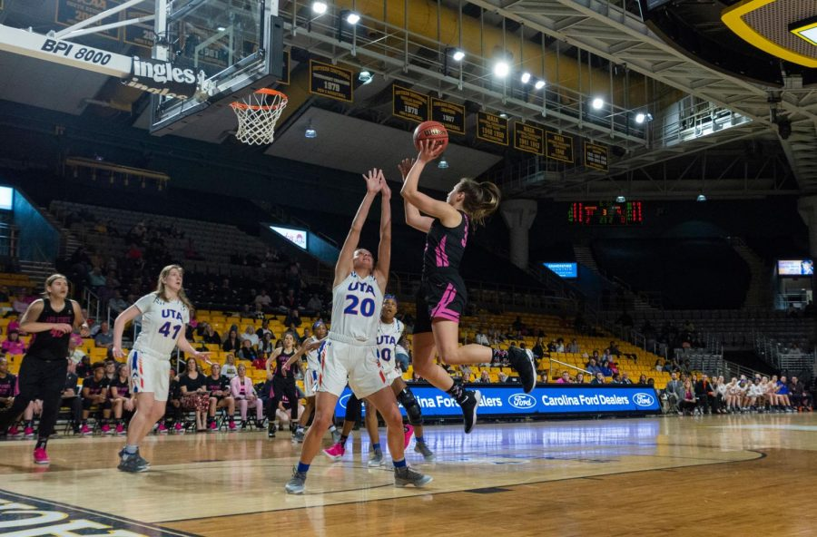 "Senior guard Madi Story shoots a floater from the corner during women's basketball's second annual ""Play4Kay"" cancer awareness game on Feb. 9."