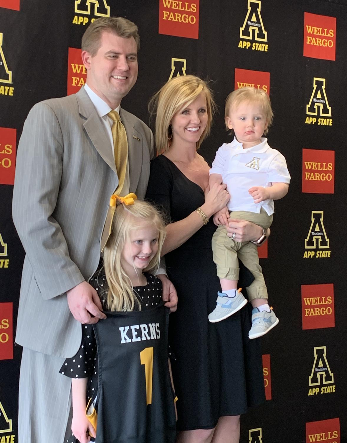 New head basketball coach Dustin Kerns pictured with his wife Brittany, daughter Emory and son Riggs.