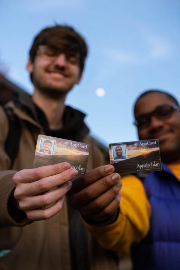 Senior Political Science major Jake Wallis (left) and senior Sustainable Development major Max Washington (right) said that being able to use their app cards as voter identification is,
