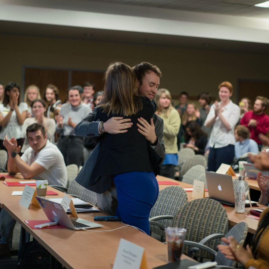 Creator of the Climate Neutrality Act Devin Mullins embraces fellow Senator Emily Hogan as the Climate Neutrality Act was passed. The bill passed unanimously Tuesday night.