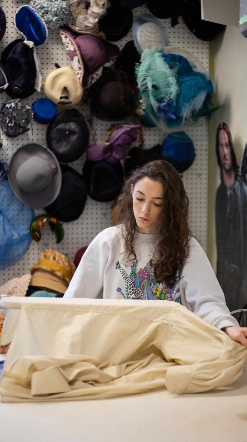 Junior dance studies major Amanda Mason works on a costume design for  the theater department's upcoming production of William Shakespeare's