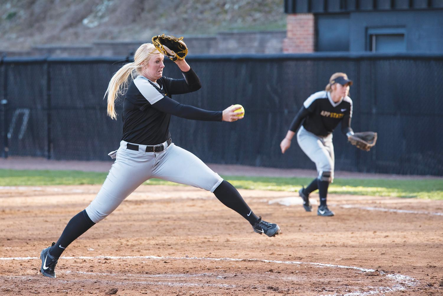Junior pitcher Kenzi Longanecker winds up and fires to the plate.