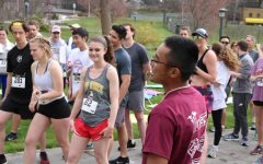Gerard Ramos blows the starting whistle at INTAPP's Coffee Buzz 5K in 2019.  participants b 5K. The organization raises money for students to be able to study abroad.