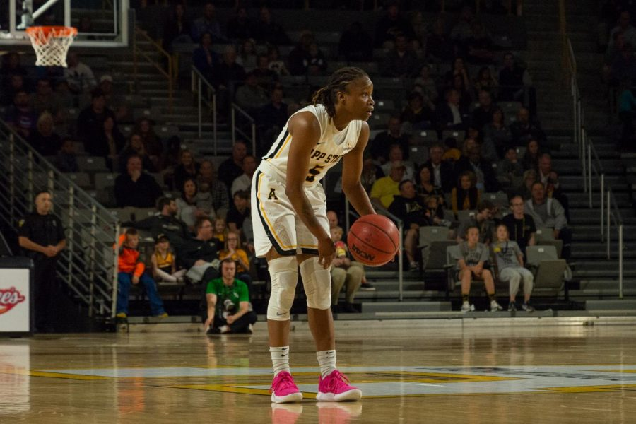 Sophomore guard Pre Stanley scans the court during the WBI championship against North Texas. Photo by Lynette Files