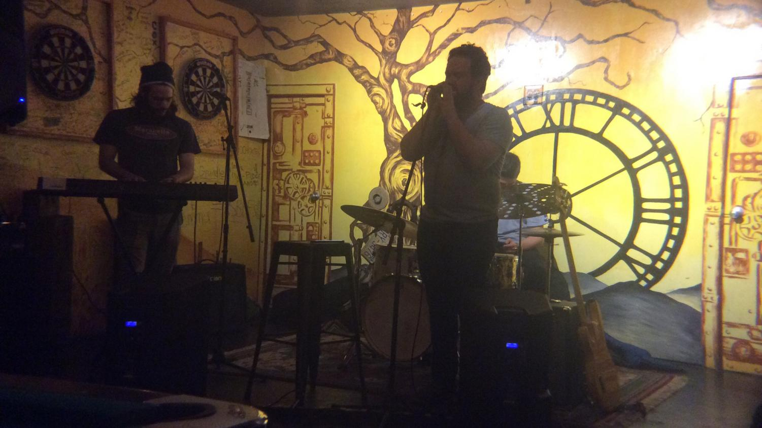 Sergio Grossi (left) and Jacob Smith (right) perform in the house band for TApp Room's Open Mic Night. The establishment hosts this event Tuesday nights every week. Photo by Q Russell