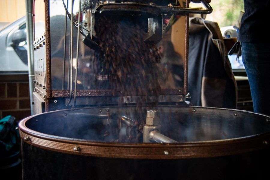 Tatum empties out freshly roasted beans for the shop's espresso blend.