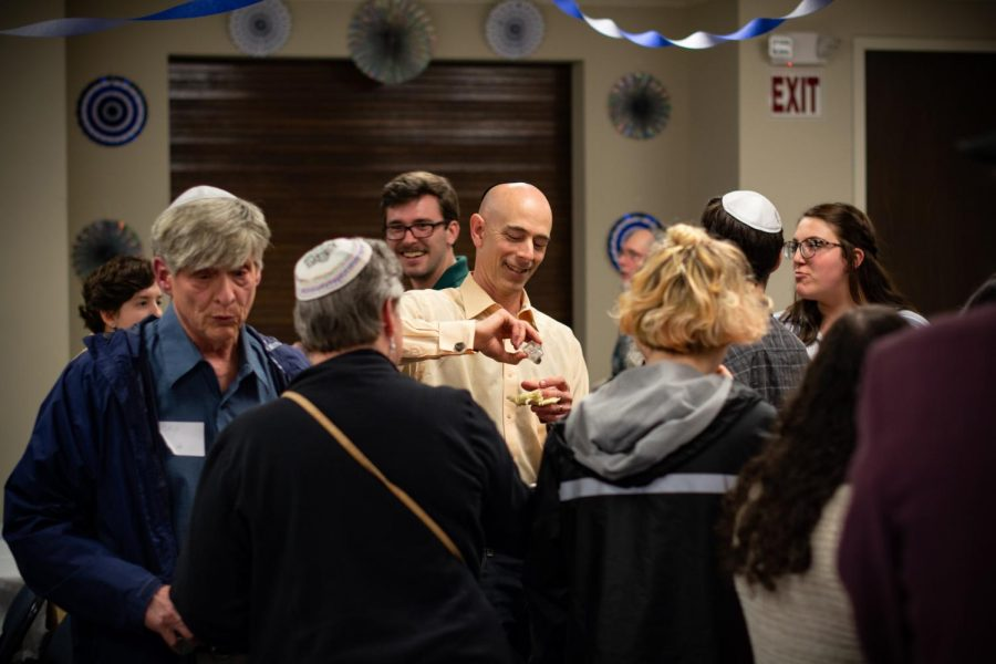 Locals celebrate following the Pride Shabbat service on Friday evening. About 40 people gathered to commemorate the LGBTQ community on Judaism's weekly day of rest.